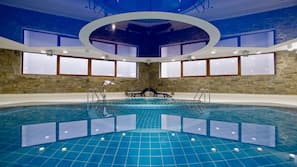 Indoor pool, open 8:00 AM to 10:00 PM, pool loungers