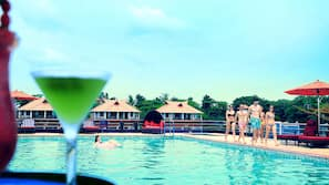 Outdoor pool, open 8 AM to 8 PM, free pool cabanas, pool umbrellas