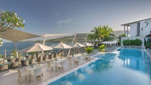 2 outdoor pools, open 10 AM to 8 PM, pool umbrellas, pool loungers