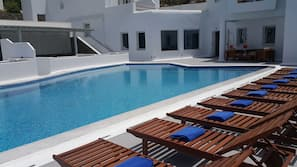 Seasonal outdoor pool, open 10 AM to 8 PM, pool umbrellas, sun loungers