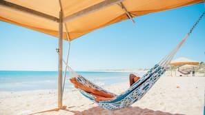 On the beach, free beach cabanas, beach volleyball, kayaking