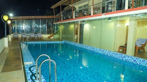Outdoor pool, open 8:30 AM to 7 PM, pool umbrellas, sun loungers