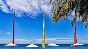 On the beach, white sand, free beach cabanas, sun-loungers