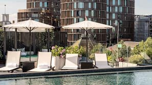 Seasonal outdoor pool, free pool cabanas, pool loungers