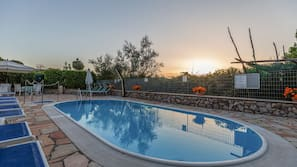 Outdoor pool, open 8 AM to 7 PM, pool umbrellas, sun loungers