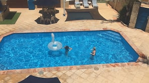 2 outdoor pools, open 8 AM to 9 PM, pool umbrellas, sun loungers