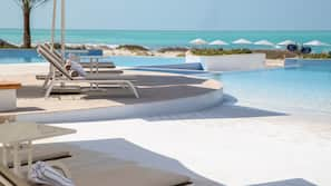 3 outdoor pools, open 7:00 AM to 6:00 PM, pool umbrellas, sun loungers