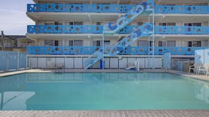 Seasonal outdoor pool, open 10:00 AM to 6:00 PM, sun loungers