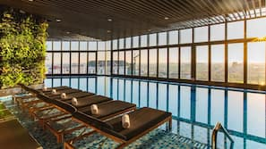 Indoor pool, open 6:00 AM to 8:00 PM, pool loungers