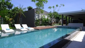3 outdoor pools, open 9 AM to 9 PM, pool loungers