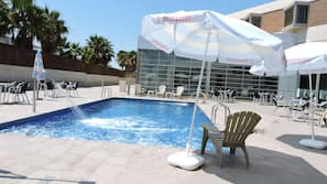 Outdoor pool, open 11 AM to 9:30 PM, pool umbrellas, pool loungers