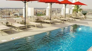 Seasonal outdoor pool, open 10:00 AM to 6:00 PM, pool umbrellas