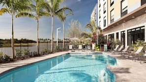 Outdoor pool, open 10:00 AM to 6:00 PM, pool umbrellas