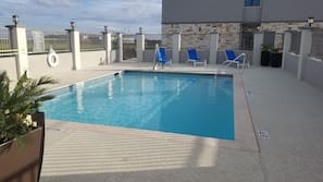 Outdoor pool, open 10:00 AM to 10 PM, sun loungers