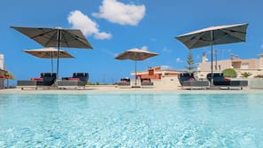 Seasonal outdoor pool, open 9:00 AM to 9:00 PM, pool umbrellas
