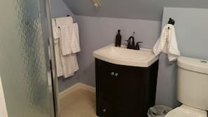 Shower, hair dryer, towels