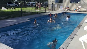 Seasonal outdoor pool, open 8:00 AM to 9:00 PM, pool loungers
