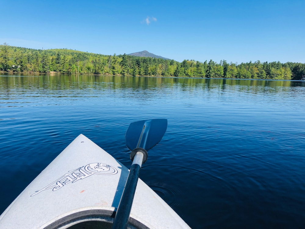 , Waterfront Chalet with private beach in the White Mountains of New Hampshire.