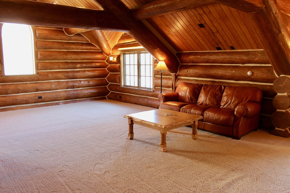 Living Room, Large, Picturesque Luxury log Home for the Whole Family