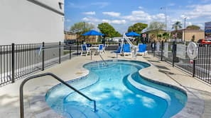Outdoor pool, open 6:00 AM to 10:00 PM, pool umbrellas