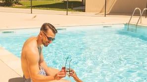 Seasonal outdoor pool, open 10:00 AM to 8:00 PM, pool umbrellas