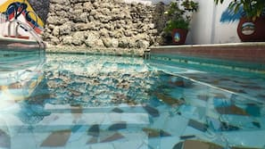 Outdoor pool, open 6 AM to 6 PM, pool umbrellas
