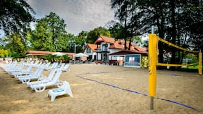 On the beach, sun loungers, beach volleyball, beach bar
