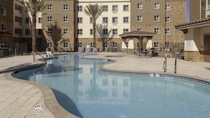 Seasonal outdoor pool, open 7 AM to 10 PM, free cabanas, pool umbrellas