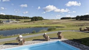 Outdoor pool, open 9:00 AM to 10 PM, sun loungers