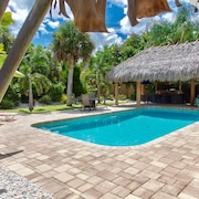 Tropical Paradise Beach Style Home With Tiki. Lots of Amenities. Great Location