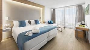 Premium bedding, down comforters, in-room safe, free WiFi