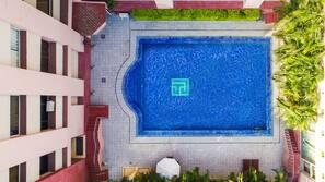 Seasonal outdoor pool, open 7 AM to 7 PM, pool umbrellas