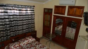 Blackout drapes, iron/ironing board, linens