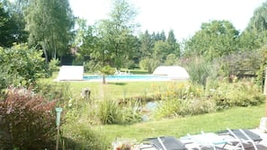 Seasonal outdoor pool, open 9:30 AM to 9 PM, pool loungers
