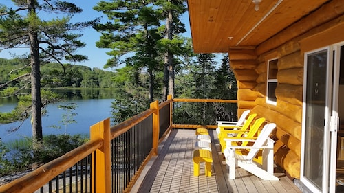 Relax In Canada: A Lakeside Log Cottage Near Kejimkujik National Park