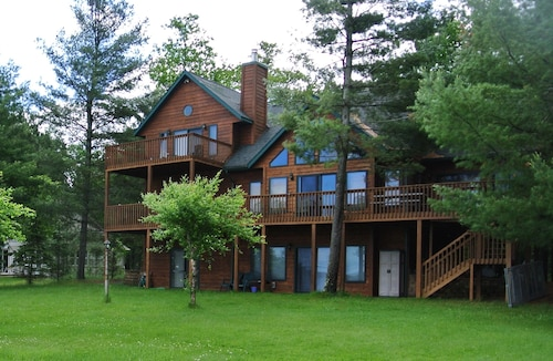 Great Place to stay Gorgeous Sunset View & Sandy Beach on Shell Lake With Game Room! near Shell Lake