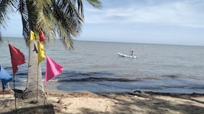Private beach, white sand, beach cabanas, beach umbrellas