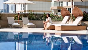 Outdoor pool, open 7 AM to 7 PM, free pool cabanas, pool umbrellas