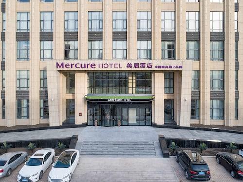 哈尔滨松北美居酒店