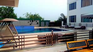 Outdoor pool, open 8 AM to 9 PM, pool umbrellas, pool loungers
