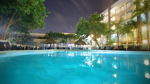 Outdoor pool, open 6:00 AM to 10:00 PM, free cabanas