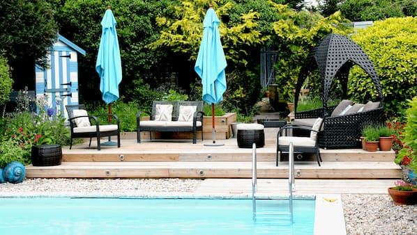 Outdoor pool, open 6 AM to 10:00 PM, pool umbrellas, pool loungers