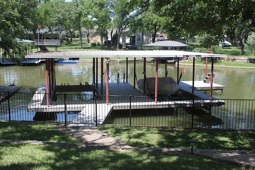 Great Place to stay Beautiful Lakefront Home - Amazing Dock W/swing Into the Water - Jet Ski Lift near Granbury