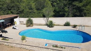 Seasonal outdoor pool, open 8:00 AM to 9:30 PM, pool loungers