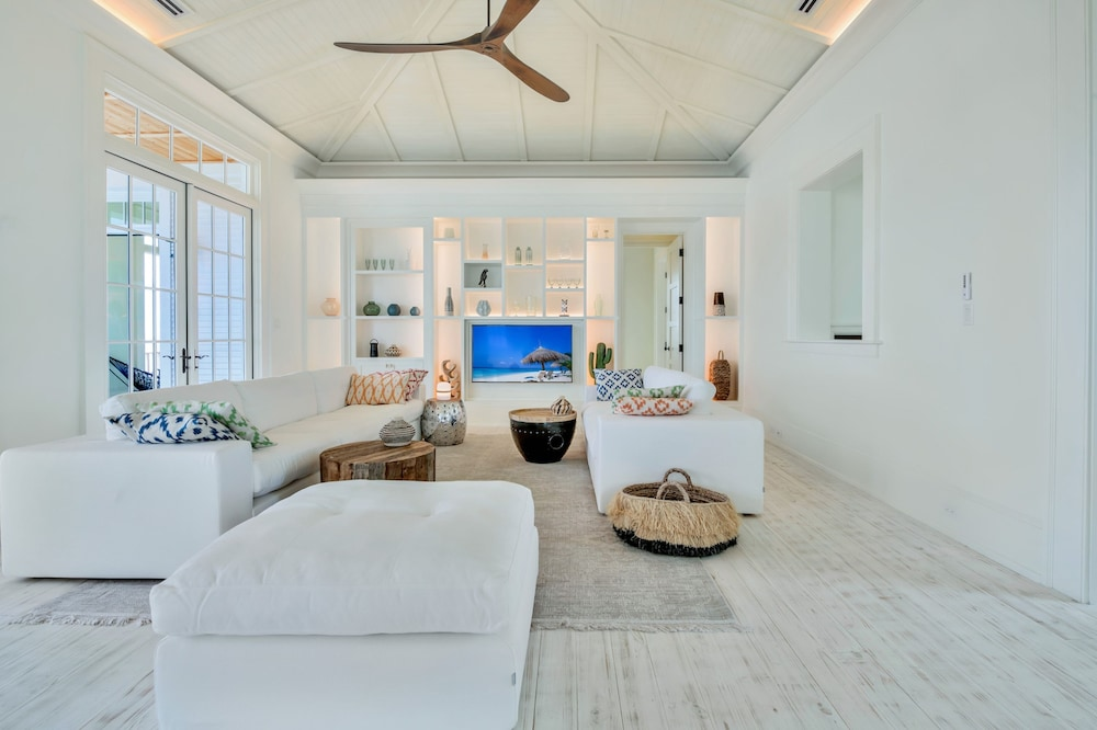Living Room, Ambergris Cay – ALL-INCLUSIVE, Private Island, Air Transfers Included