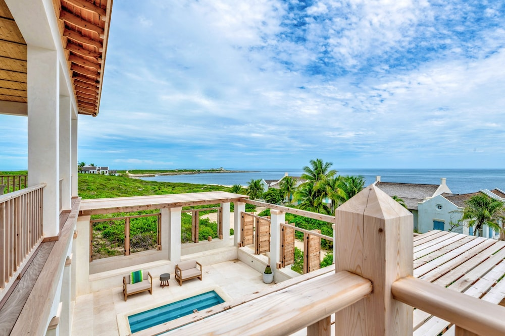 Balcony, Ambergris Cay – ALL-INCLUSIVE, Private Island, Air Transfers Included