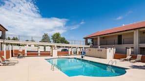 Seasonal outdoor pool, open 8:00 AM to 10:00 AM, sun loungers