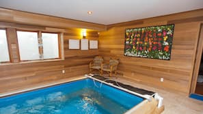 Indoor pool, seasonal outdoor pool, open 9 AM to 8 PM, pool umbrellas