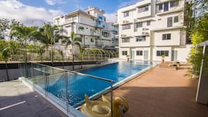 Outdoor pool, open 7 AM to 10 PM, pool umbrellas, sun loungers