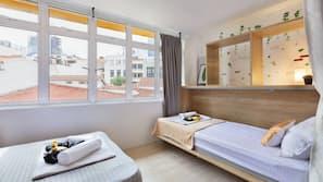 Premium bedding, down duvets, desk, laptop workspace
